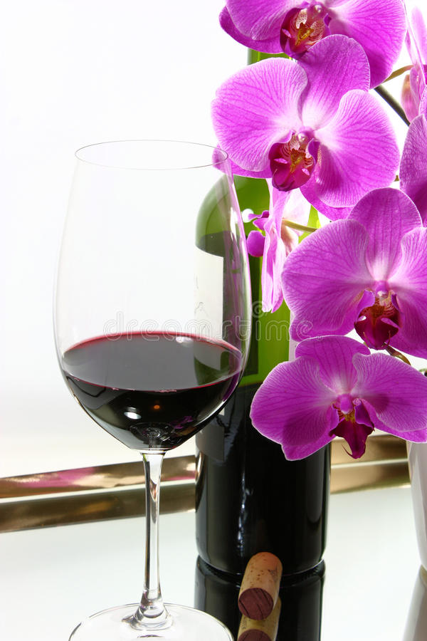Red Wine & Orchids royalty free stock photography
