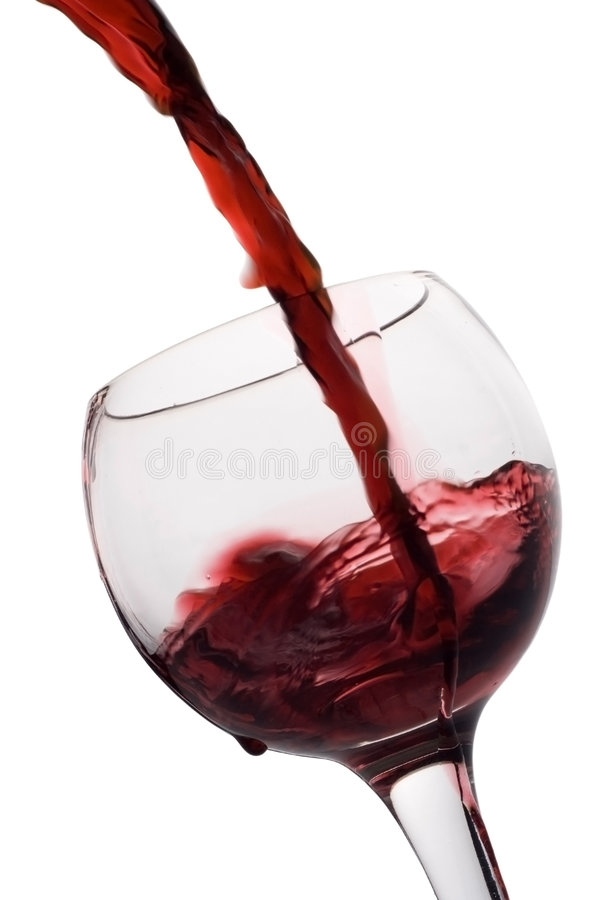 Red wine poured into a glass stock image