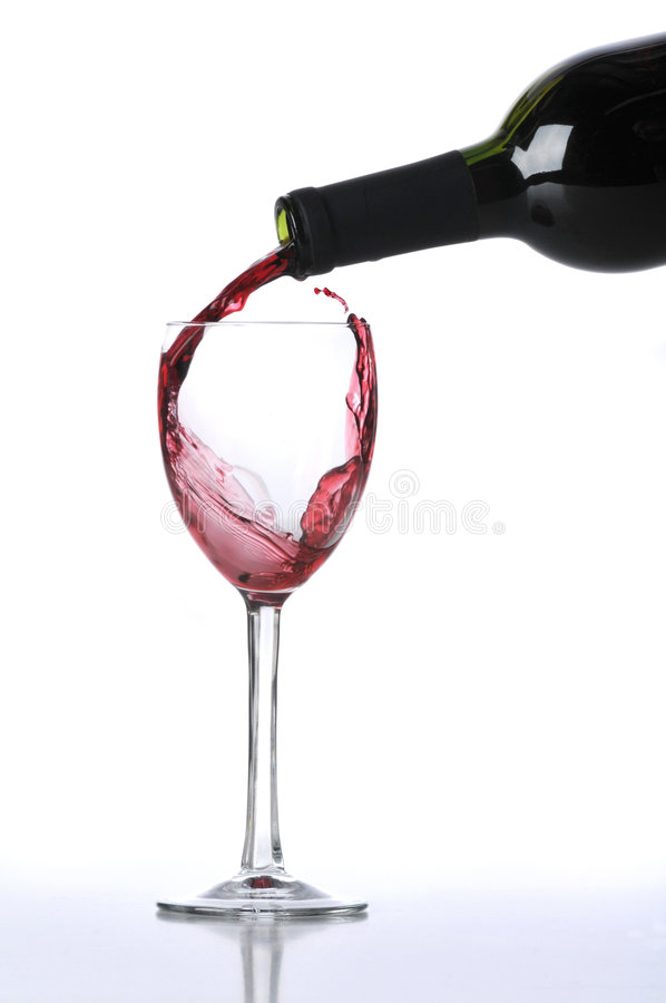 Red wine poured on glass stock photos