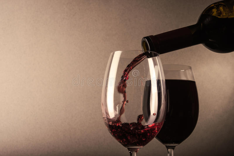 Red wine poured stock images