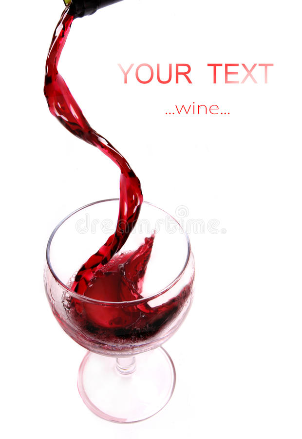 Red wine pouring royalty free stock image