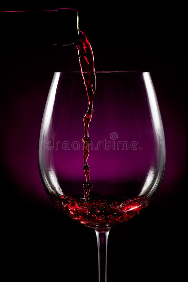 Download Red wine pouring on black stock photo. Image of merlot - 29016450