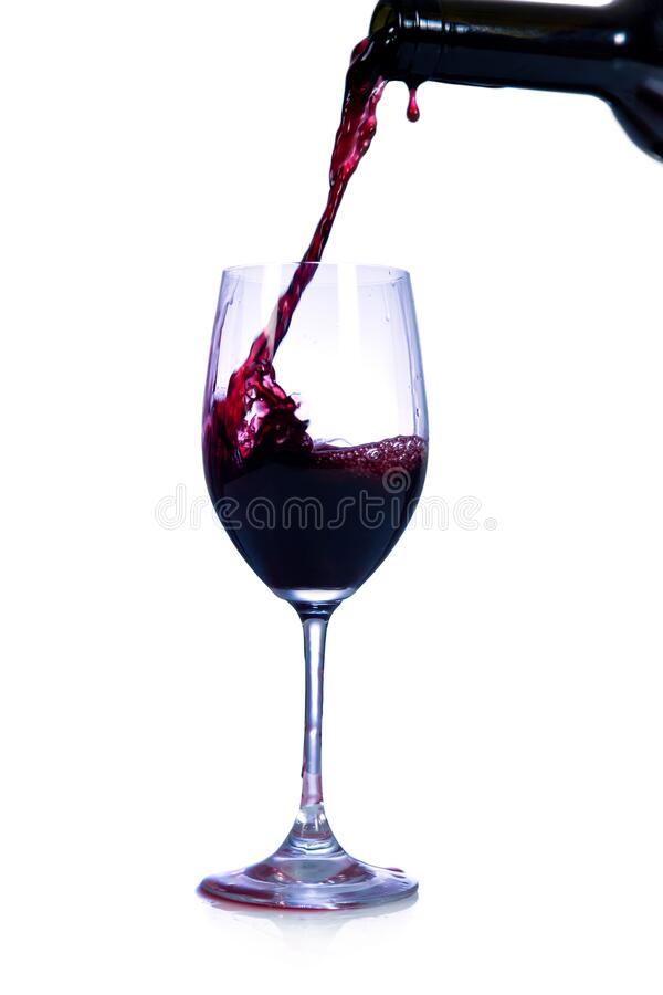 Red wine pouring from bottle royalty free stock image