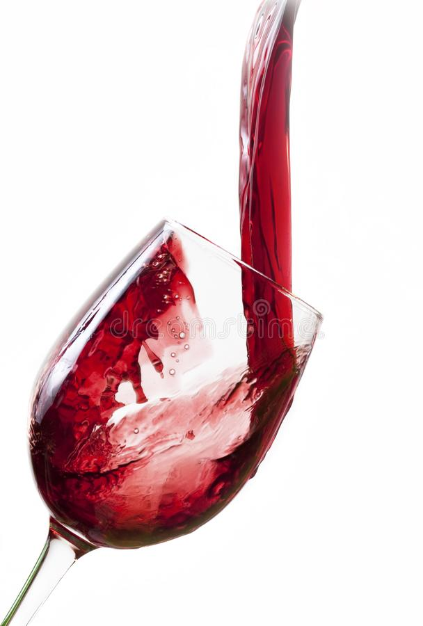 Red wine pouring into glass royalty free stock photo