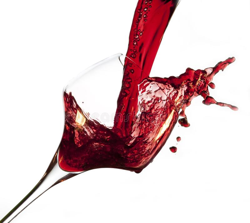 Red wine pouring into glass stock images