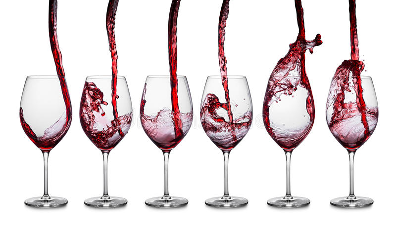 Red wine pouring row royalty free stock photography