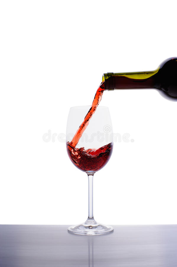 Download Red Wine Pouring Into Wine Glass Stock Photo - Image: 27975948