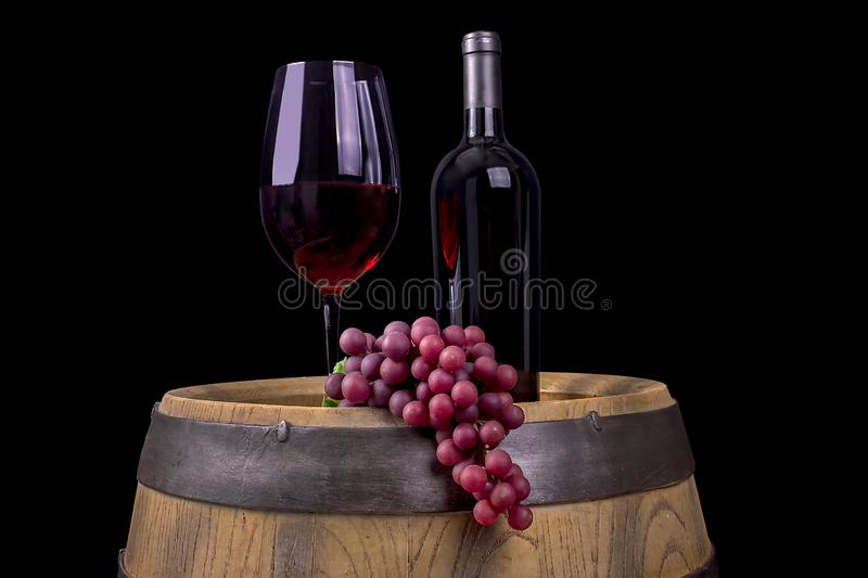 Red Wine On A Barrel, Black Background royalty free stock images