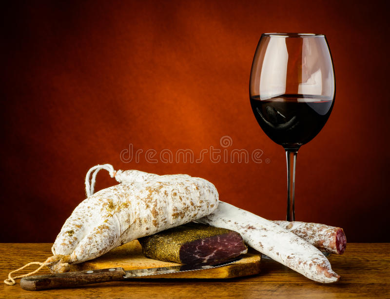 Red wine and sausages stock photography