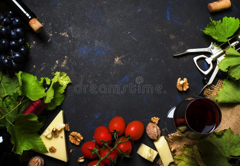 Red wine and snacks, Italian food concept, black background, top stock photography