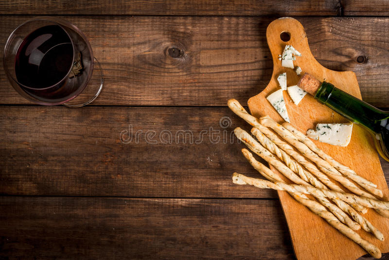 Red wine and snacks for it stock photos
