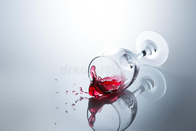 Red wine spilled out of a falling glass royalty free stock photo