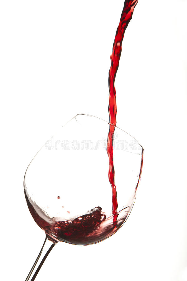 Red wine splash on a glass stock images