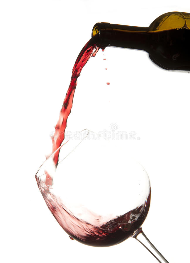 Red wine splash on a glass royalty free stock photo