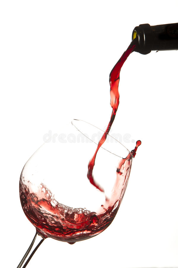 Red wine splash on a glass royalty free stock photography
