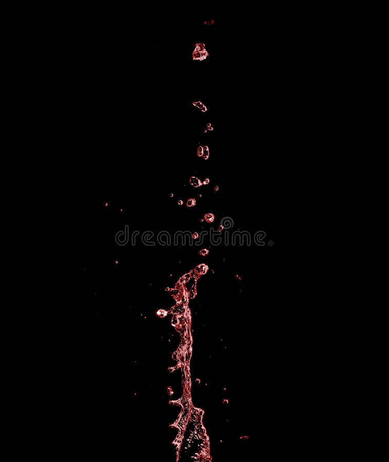 Red wine splash with knots stock photo