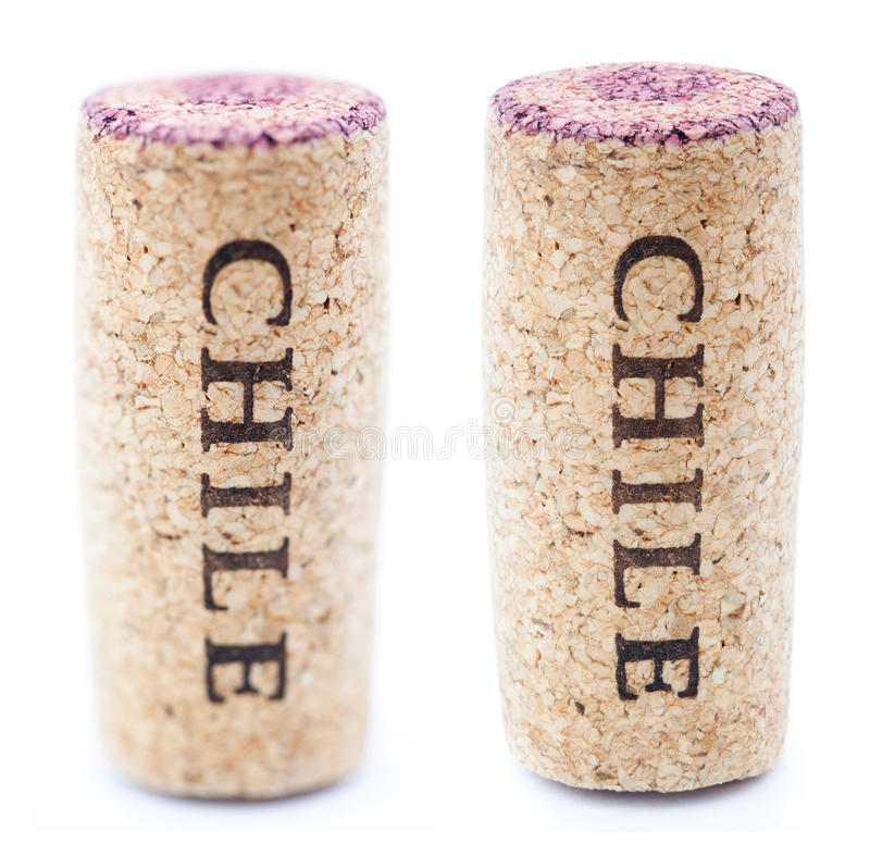 Isolated Chile Wine Corks. A red wine stained wine cork with 'Chile' written on it, isolated on white background, in vertical position with the writing pointing stock photography