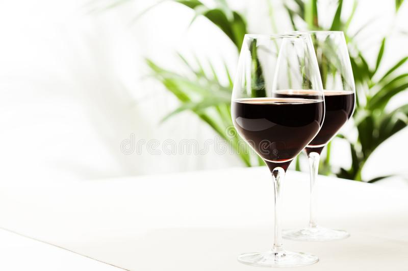 Red wine. Two glasses of red wine on white background stock photo