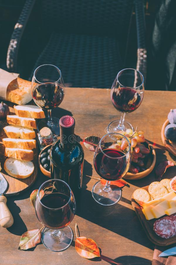 Red wine and variation of snacks stock photo