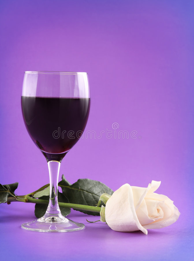 Red wine and white rose royalty free stock image