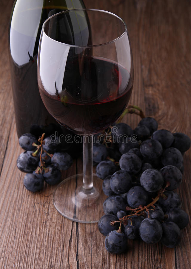 Red wineglass and grape royalty free stock photos