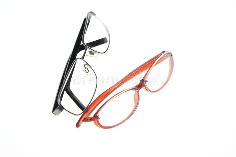 Red woman glasses made of plastic and black man glasses made of metal royalty free stock photos