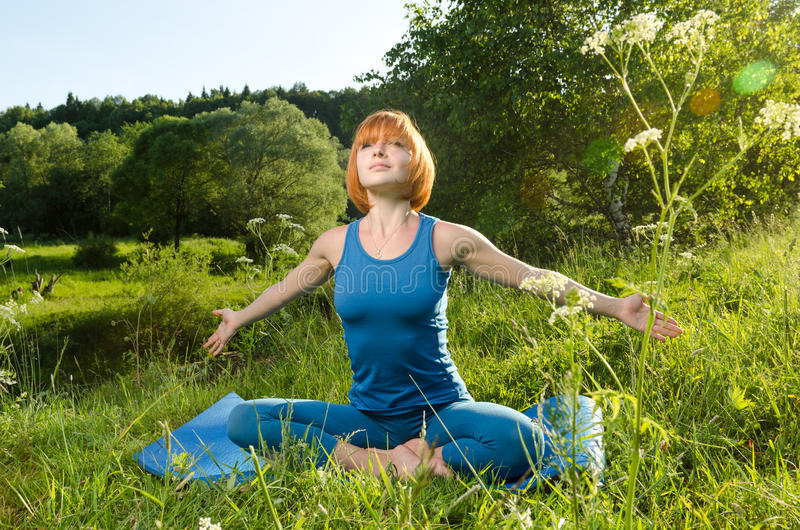 Red Woman Practicing Fitness Yoga Outdoors Royalty Free Stock Images