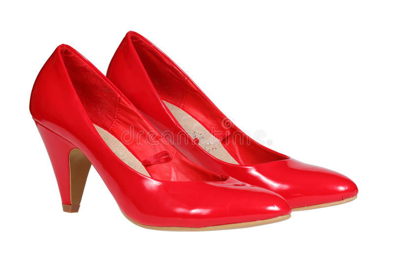 Red women's heel shoes. A pair of red women's heel shoes isolated over white with clipping path stock photo