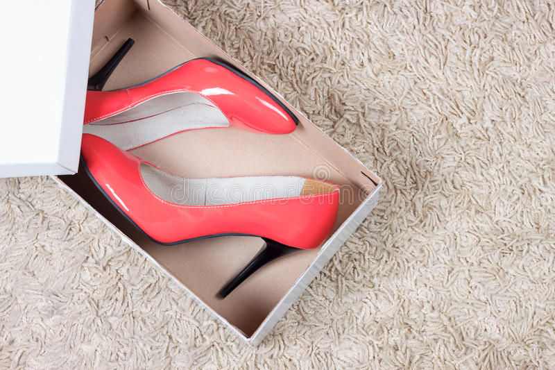 Red women shoes in box stock photos