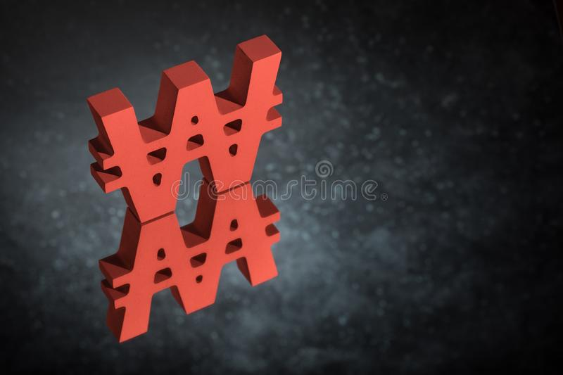 Red Won Symbol or Sign With Mirror Reflection on Dark Dusty Background. Red South Korean Currency Symbol or Sign Won With Mirror Reflection on Dark Dusty stock photo