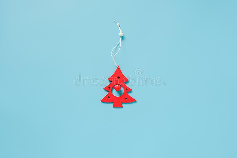 Red wood christmas decoration tree toy on blue background with copy space. Concept Merry christmas or Happy new year. Minimal royalty free stock image