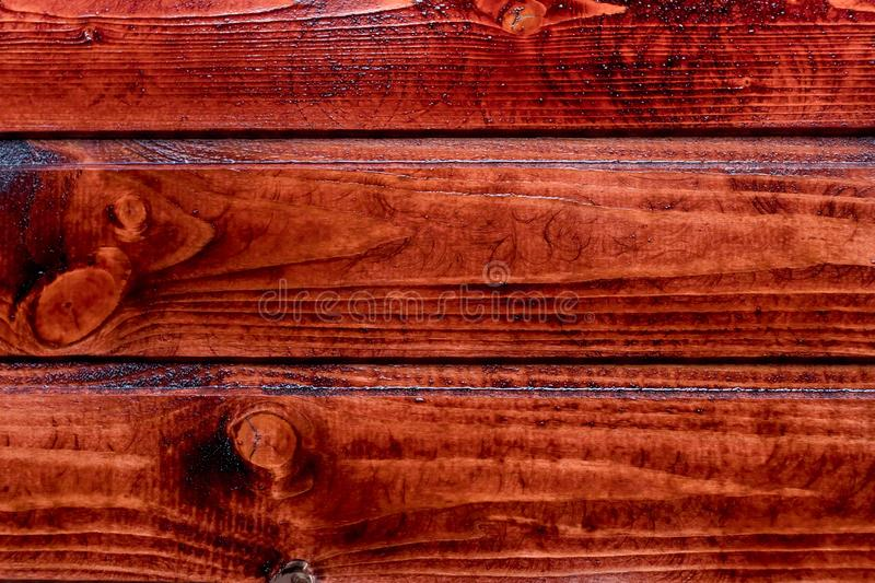 Red wood planks texture grunge.Red dark natural wood. dark natural pattern. Can be used for wallpaper, pattern fills stock images