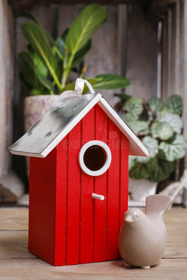 Red wooden bird house royalty free stock image