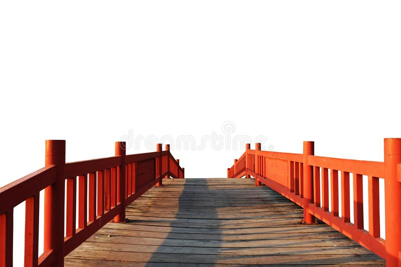 Red wooden bridge on white background. royalty free stock photography