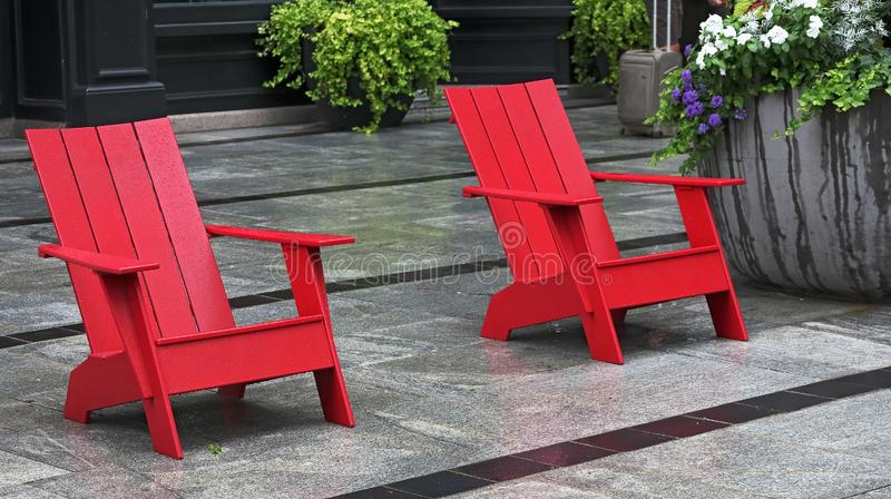Red wooden chairs on a Boston street royalty free stock image