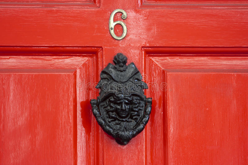 A red wooden door stock image