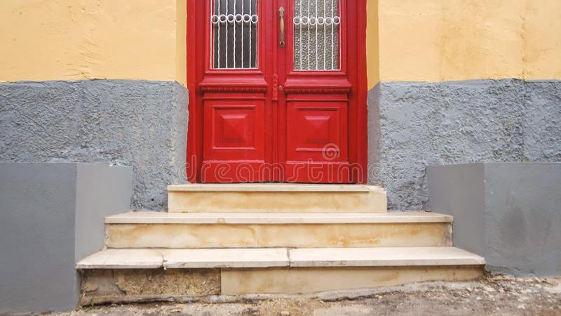 Red Wooden Door in Corfu Town, Corfu, Greece. Red wooden door in Corfu Town on the island of Corfu, Greece royalty free stock image