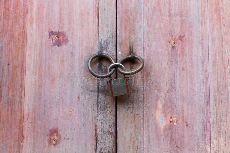 Red wooden door with old door knob. Lock the door stock photos