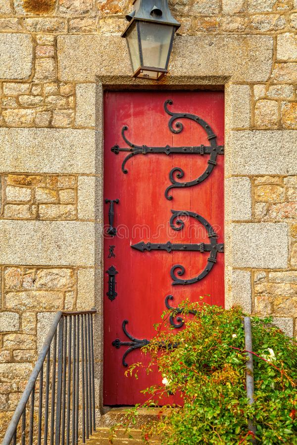 Red wooden door. Old red wooden door in a stone frame royalty free stock photos