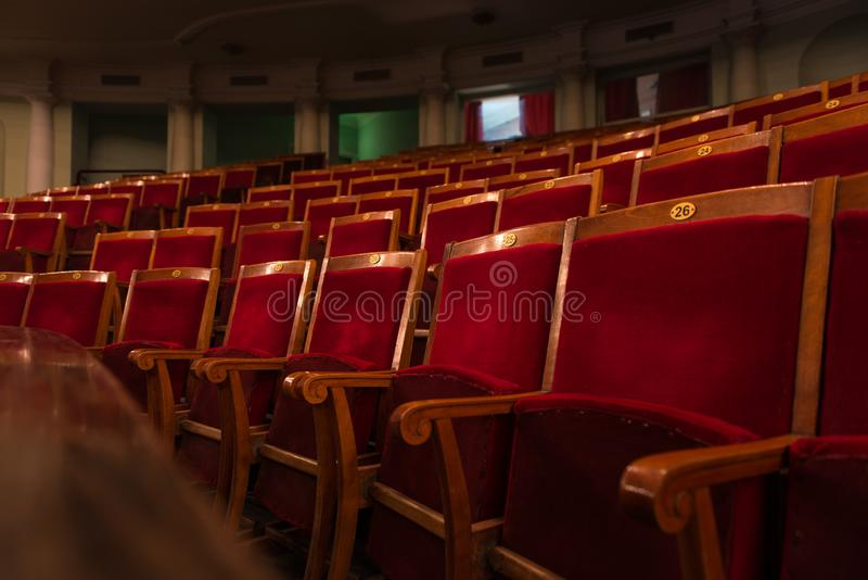 Red wooden empty seats in theatre. Horizontal image. Empty hall royalty free stock photography