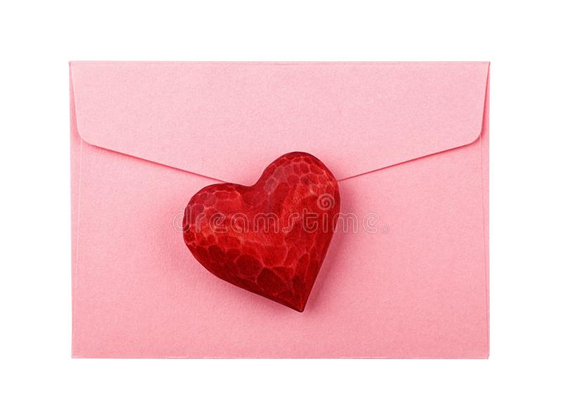 Red wooden heart on envelope isolated on white stock image
