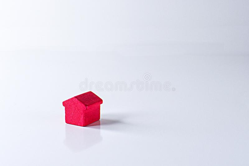 Red wooden house on a white background. Small red wooden house on a white background royalty free stock photography