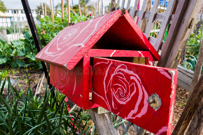 Red wooden letterbox with a floral pattern stock photo image of download red wooden letterbox with a floral pattern stock photo image of kilda wooden spiritdancerdesigns Gallery