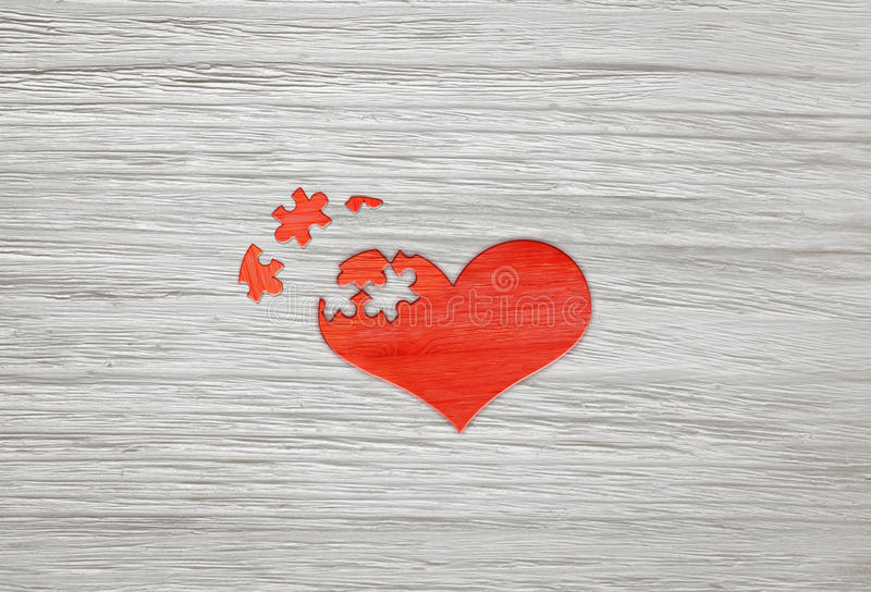 Download Red Wooden Puzzle Heart On Grey Background Stock Photo - Image: 83702235