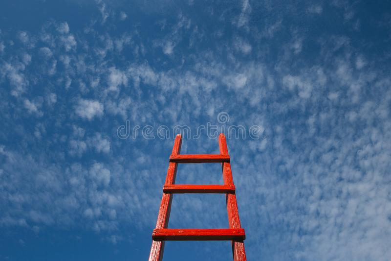 Red Staircase Rests Against Blue Sky. Development motivation Career Growth Concept stock images