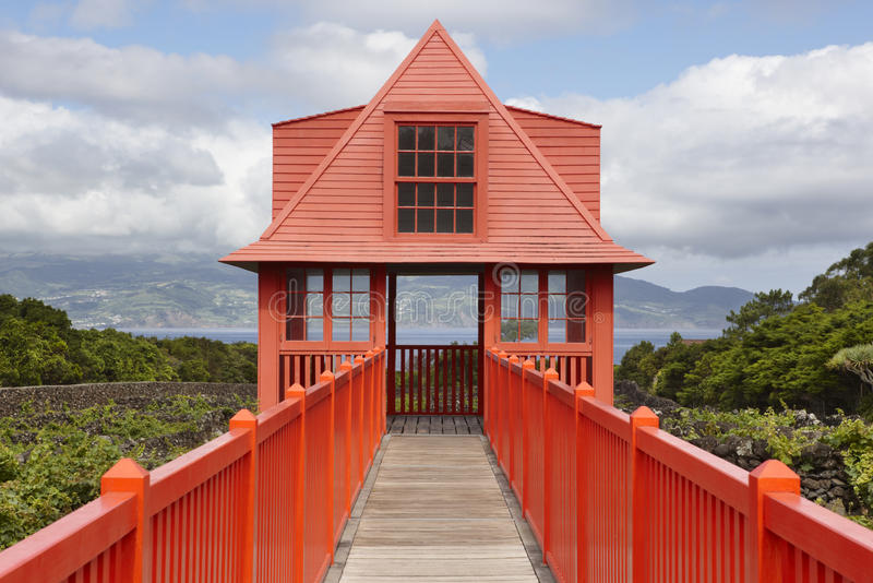 Red wooden viewpoint pathway in Pico island vineyard. Azores. Po. Rtugal. Horizontal stock images