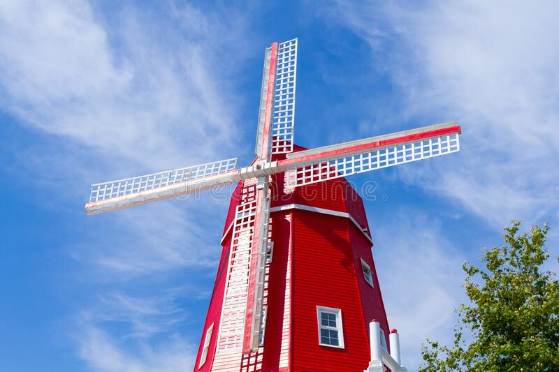 Red wooden windmill stock image