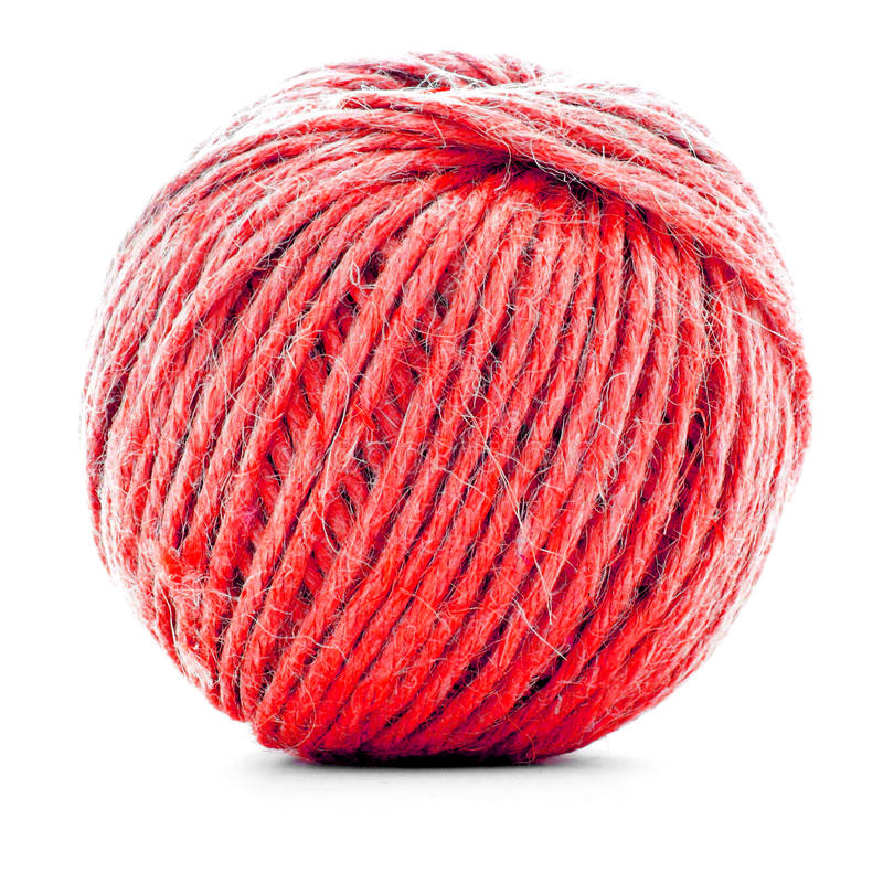 Red wool skein, knitting thread roll isolated on white background stock photos