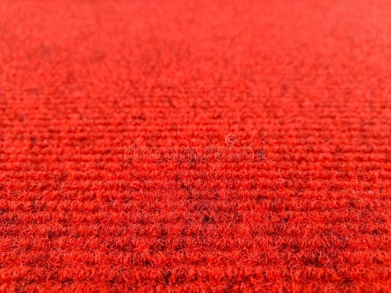 Red woolen carpet background with perspective view, selective focus stock photos