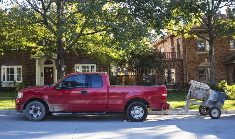 Red work pick up truck with cement mixer parked on street in traditional neighborhood stock photos